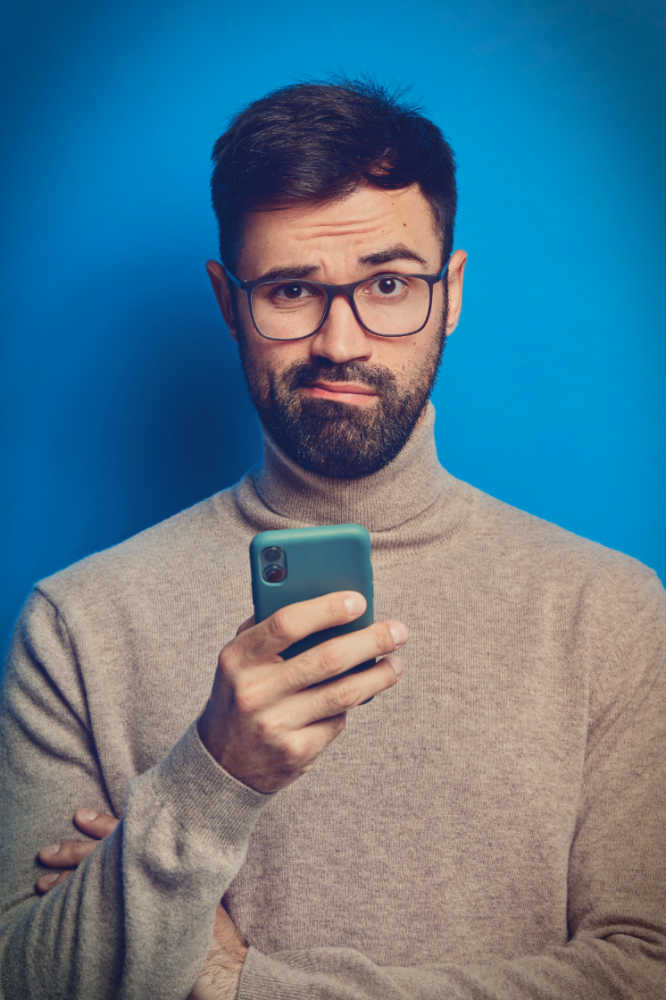 Unhappy man with slow web loading on mobile